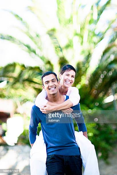 Couple piggyback in the park