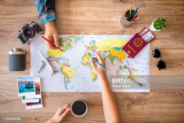 couple planning a travel - journey stock pictures, royalty-free photos & images