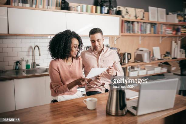 Couple planning their finances on the kitchen