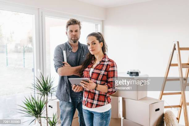 Couple planning their new home, using virtual reality goggles