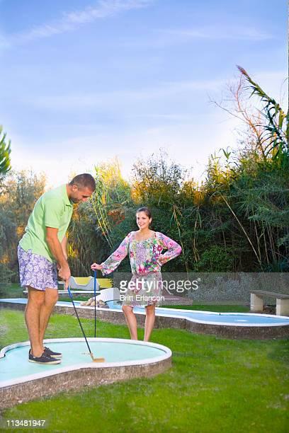 Couple play minature golf