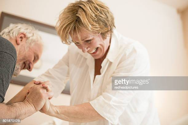 couple playfighting - rough housing stock photos and pictures