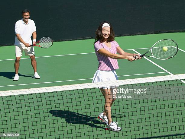 Couple Playing a Game of Tennis