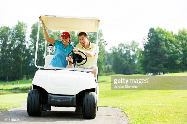 A couple playing a round of golf.