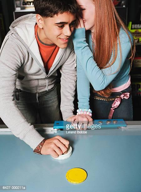 Couple Playing Air Hockey