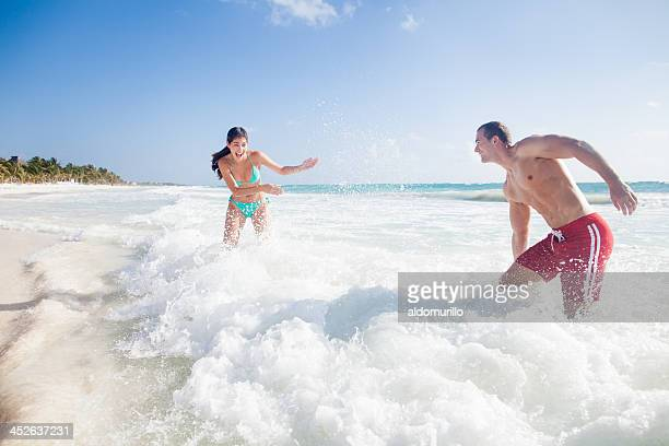 couple playing at the beach - cancun stock pictures, royalty-free photos & images