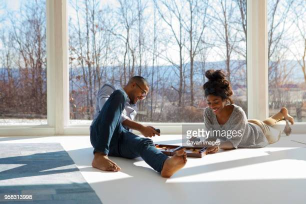 Couple playing backgammon at home
