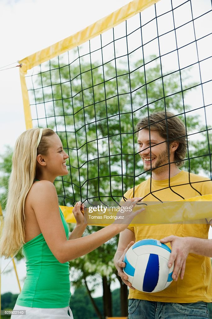 Couple Playing Beach Volleyball : Stockfoto