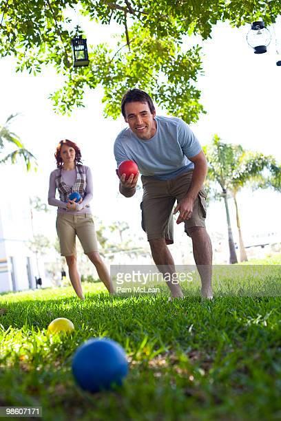 Couple playing bocce ball
