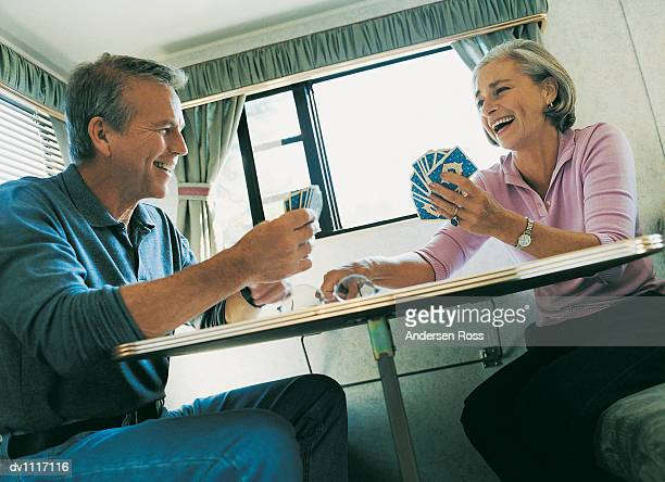 Couple Playing Cards in Their Motor Home