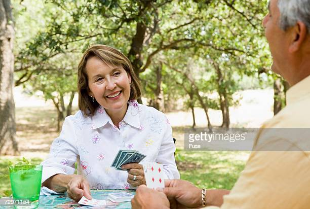 Couple playing cards together outdoors