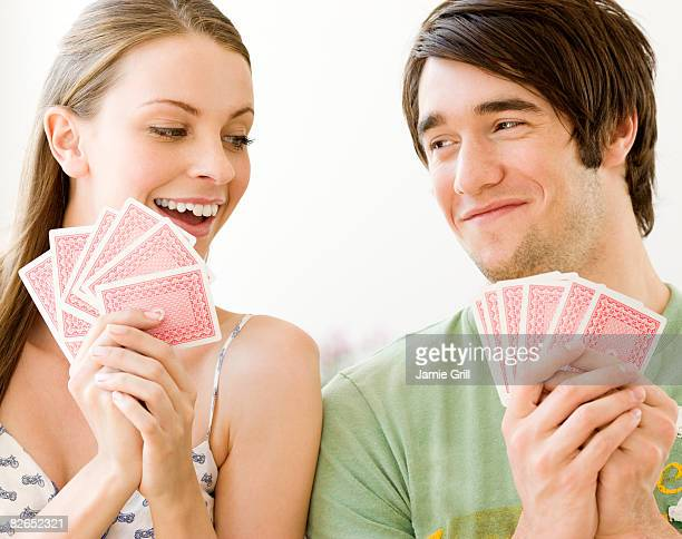 couple playing cards together - hand of cards stock photos and pictures