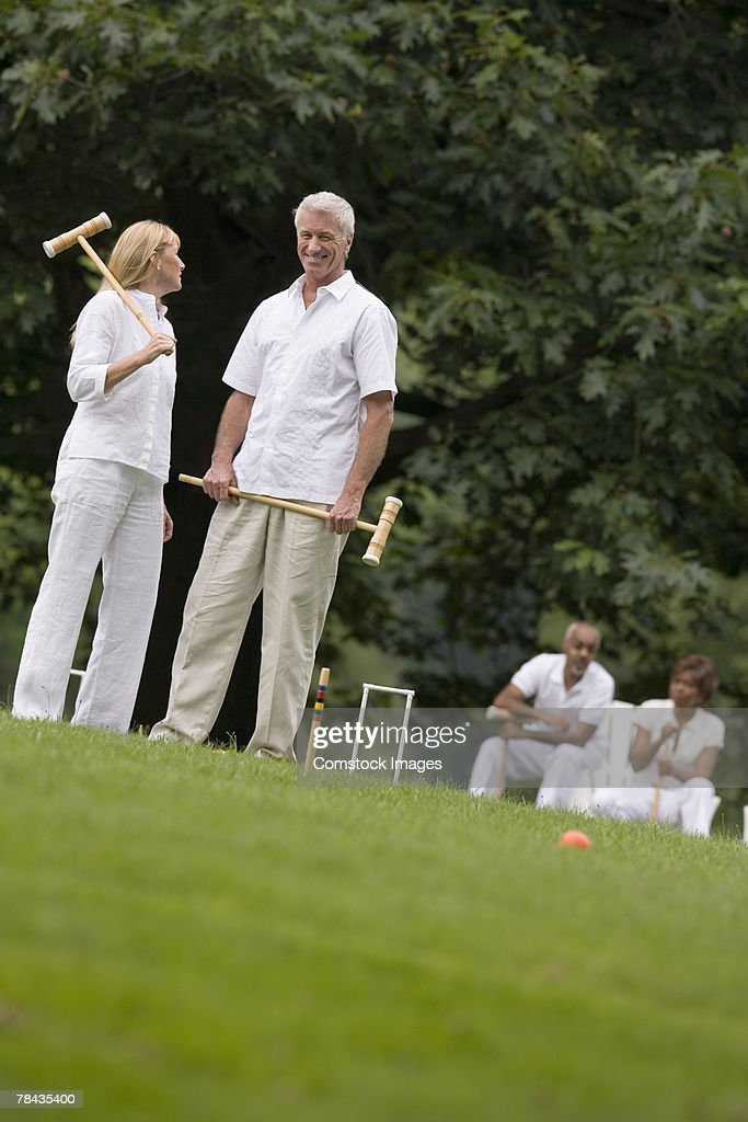 Couple playing croquet : Stock Photo