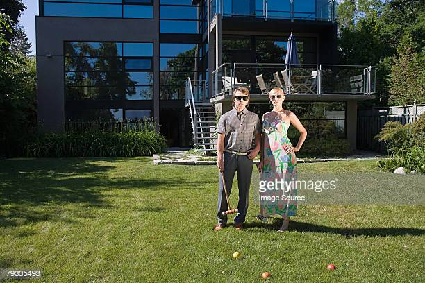 A couple playing croquet