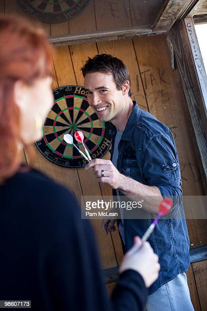 couple playing darts