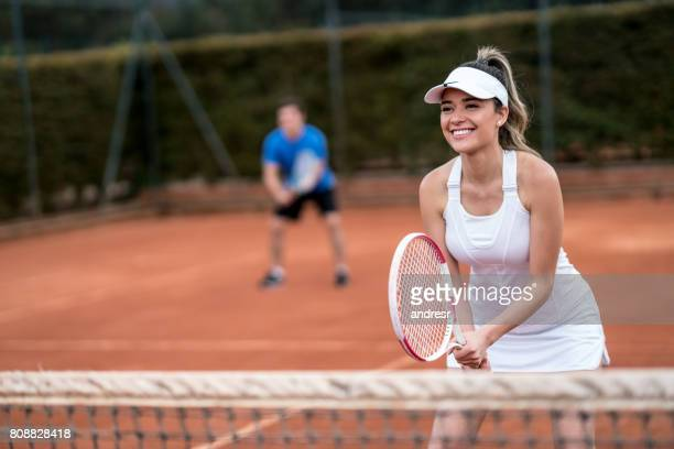 couple playing doubles in a tennis match - doubles stock photos and pictures