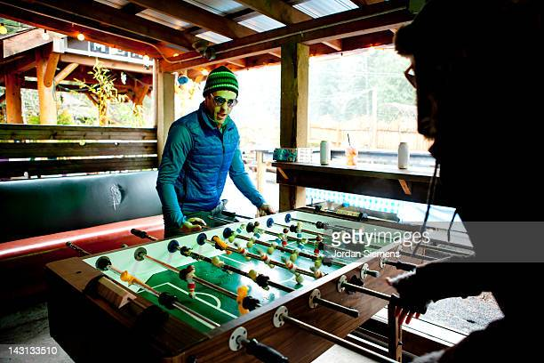 A couple playing foosball.
