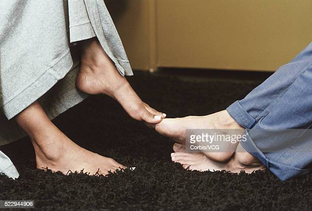 Couple Playing Footsie