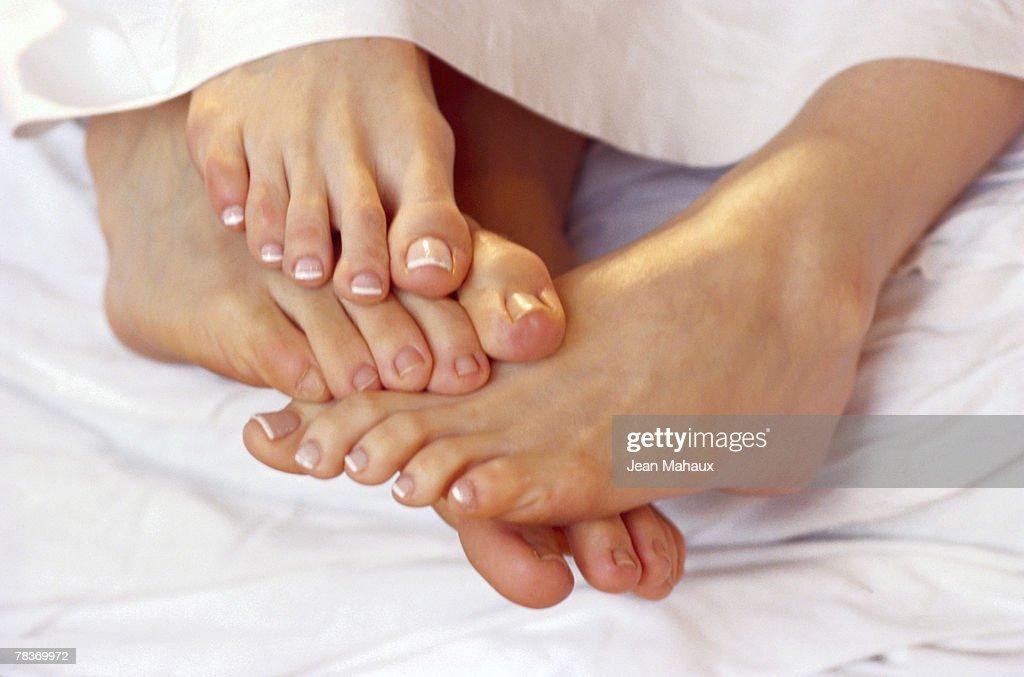 Couple playing footsie : Stock Photo