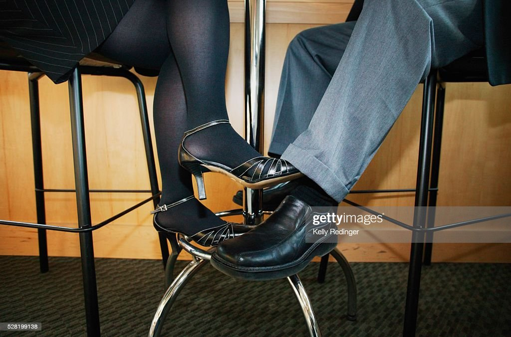 Couple Playing Footsie Under the Table : Stock Photo