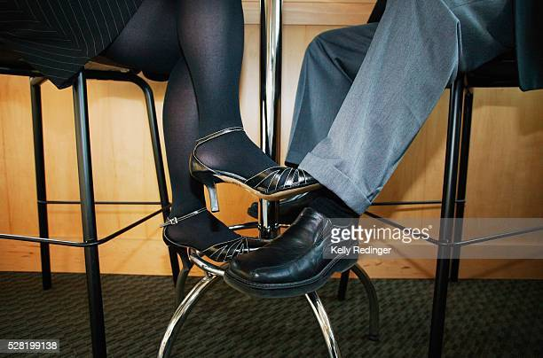 Couple Playing Footsie Under the Table