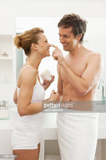 Couple playing in bathroom