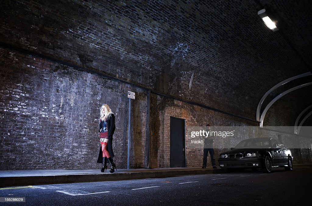 Couple playing master and servant in a dark highway tunnel. : Stock Photo
