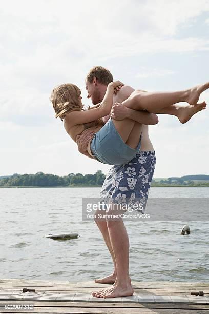 Couple playing on dock