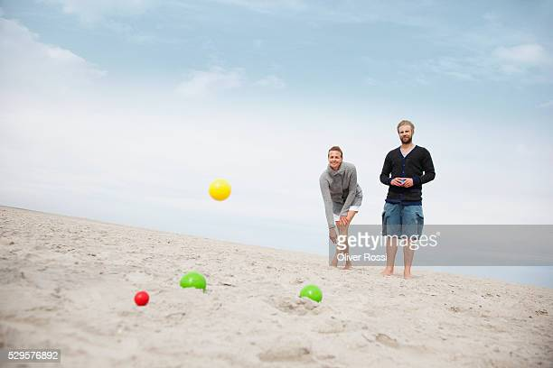 Couple playing on the beach