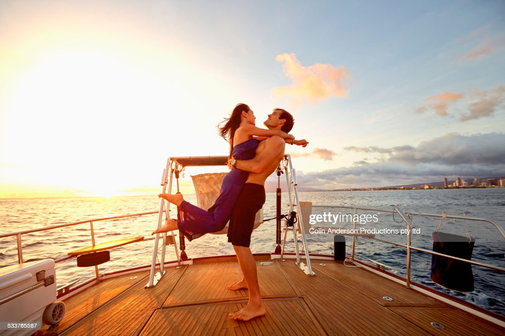Couple playing on yacht deck : Foto stock
