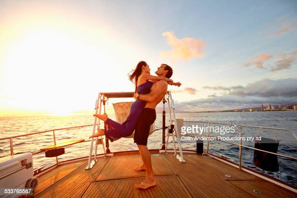 Couple playing on yacht deck