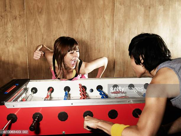 Couple playing table football