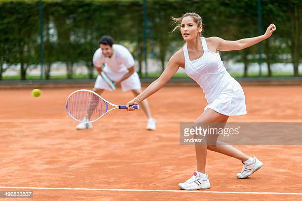 couple playing tennis - doubles stock photos and pictures
