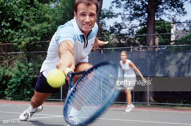 couple playing tennis - doubles sports competition format stock pictures, royalty-free photos & images