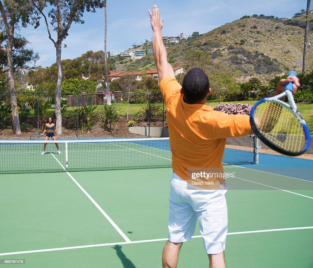 Couple playing tennis : Stock Photo