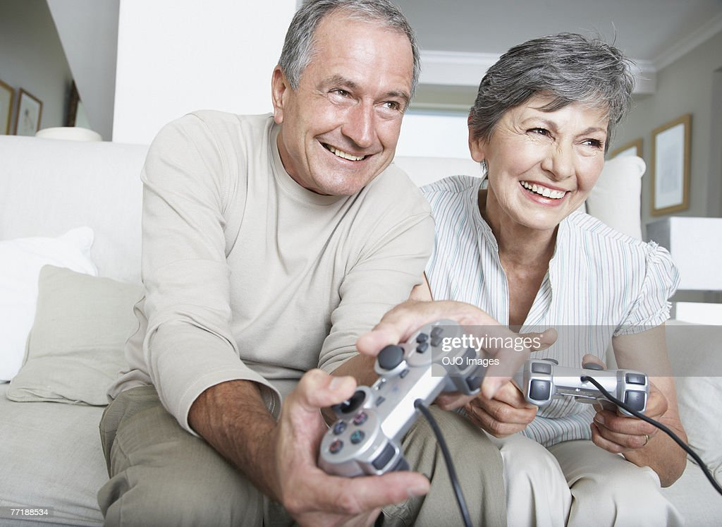 A couple playing videogames : Stock Photo