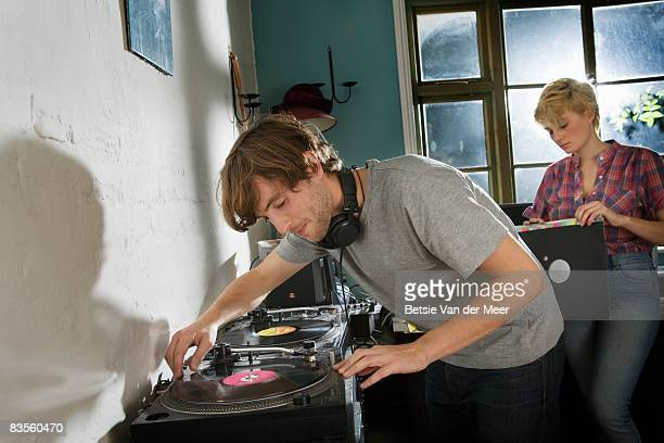 couple playing vinyl records.
