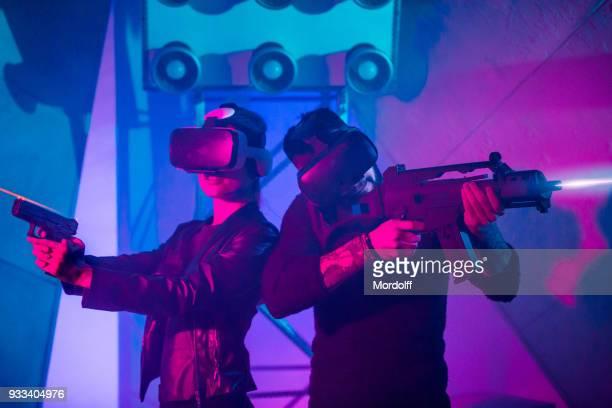 Couple Playing Virtual Reality Shooter Using Headset