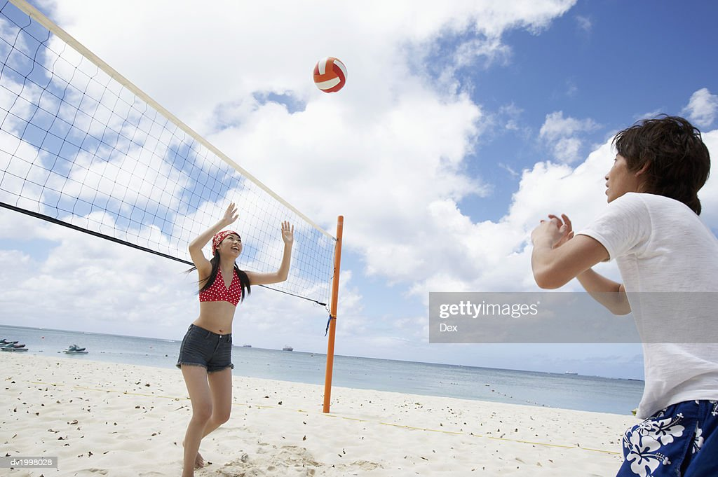 Couple Playing Volleyball on the Beach : Stock Photo