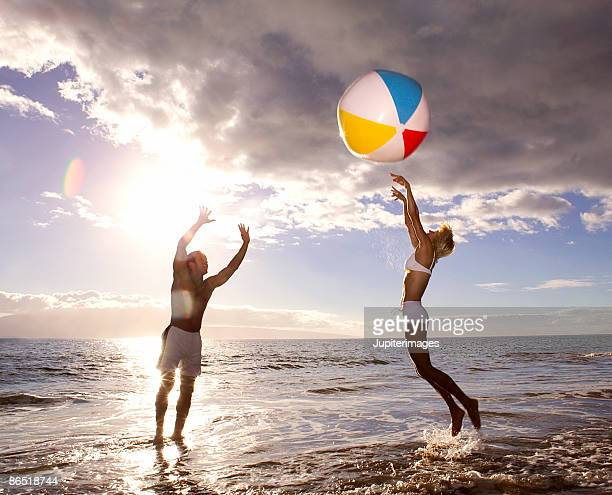 Couple playing with beach ball
