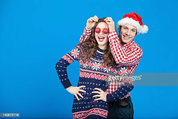 Couple playing with Christmas ornaments
