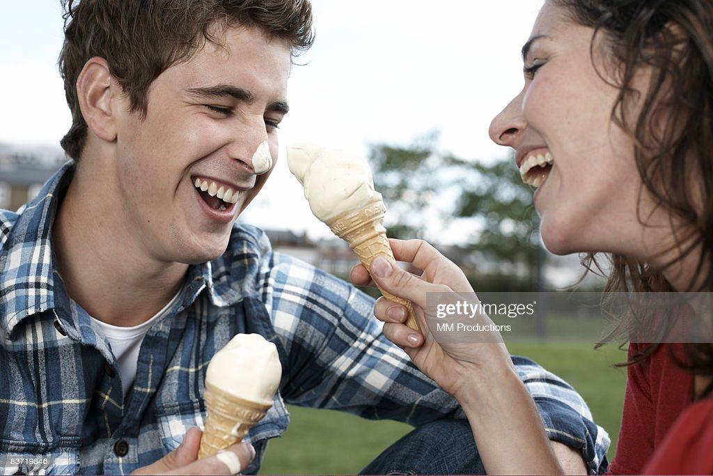 Couple playing with ice cream cones : Stock Photo