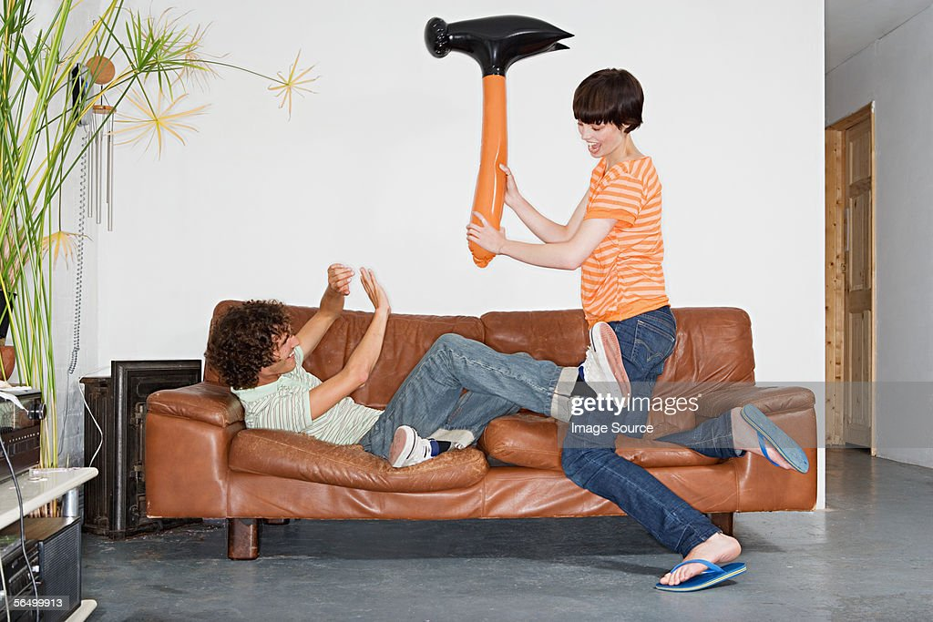 Couple playing with inflatable hammer : Stock Photo