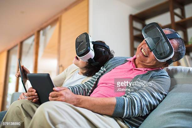 Couple playing with virtual reality headsets