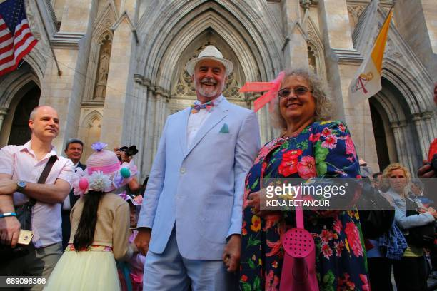 A Couple pose for a picture in front of St Patrick's Cathedral as they attend the annual Easter Parade and Easter Bonnet Festival on the Fith avenue...