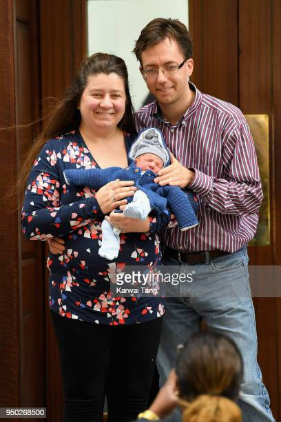 A couple pose with their newborn baby outside the Lindo Wing on the same day as the announcement that Catherine Duchess of Cambridge has given birth...