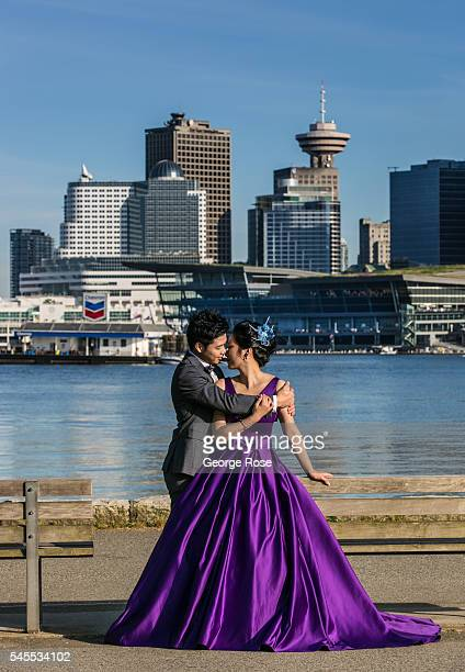A couple poses for a prom photo in Stanley Park with the city skyline as a backdrop on June 30 in Vancouver British Columbia Canada Vancouver the...