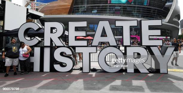 A couple poses in front of a CREATE HISTORY sign at a Vegas Golden Knights road game watch party for Game Three of the 2018 NHL Stanley Cup Final...