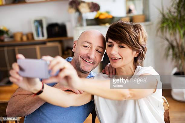 couple posing for a selfie at home