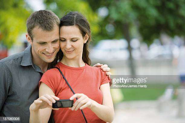 Couple posing for photo outdoors